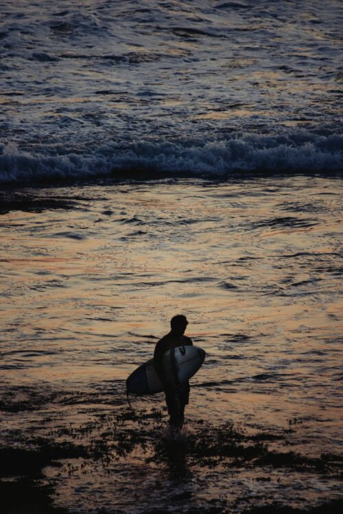 Surfer under the Tanah Lot Temple